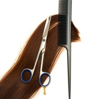 Brown hair with a comb and scissors